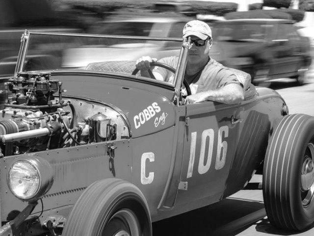 Ralph Whitworth in Tom Cobbs Roadster.jpg