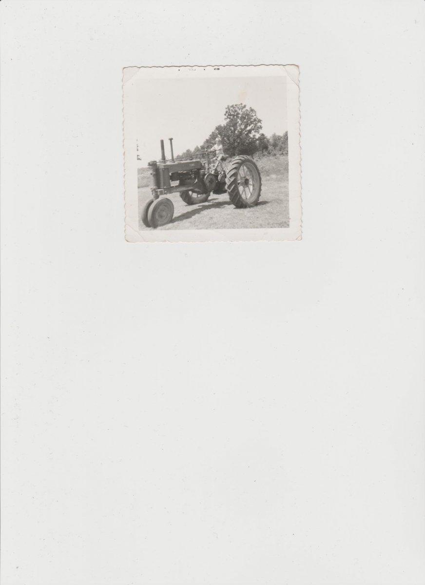 Randy driving tractor 1958.jpeg