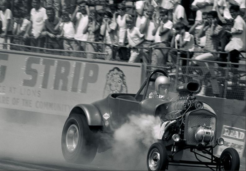 Roadster engine explosion at AHRA meet Lions.JPG