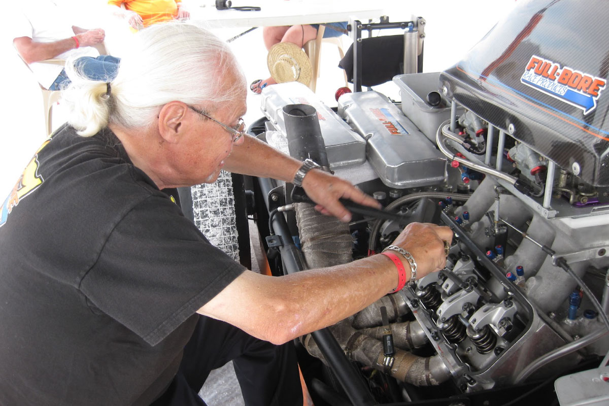 Roy wrenching on the Full Bore Roadster.jpg