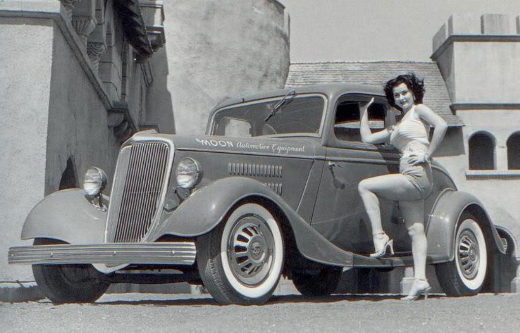 Ruth Hampton posing with Dean Moon's '34 Ford Coupe.jpg