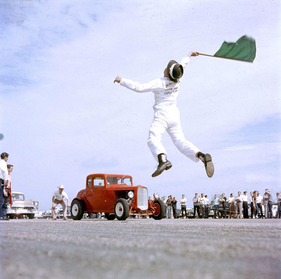 Starter flagging dragsters to start at Eagle Mt. Fort Worth, Texas 1957.jpg