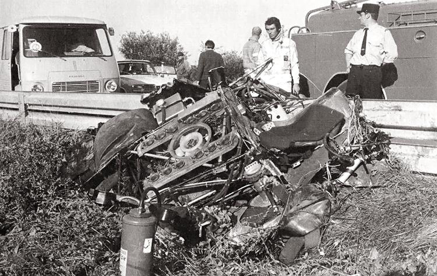 Steve McQueen surveys the wreckage of David Piper's Porsche.jpg