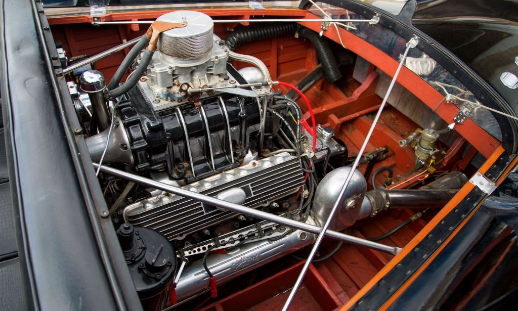 Supercharged Caddy in Jim Skonzakes' 1955 Chris-Craft Black Cobra (1).JPG