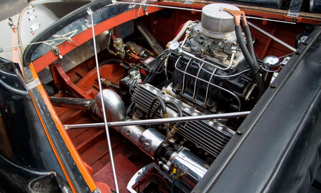 Supercharged Caddy in Jim Skonzakes' 1955 Chris-Craft Black Cobra (2).JPG
