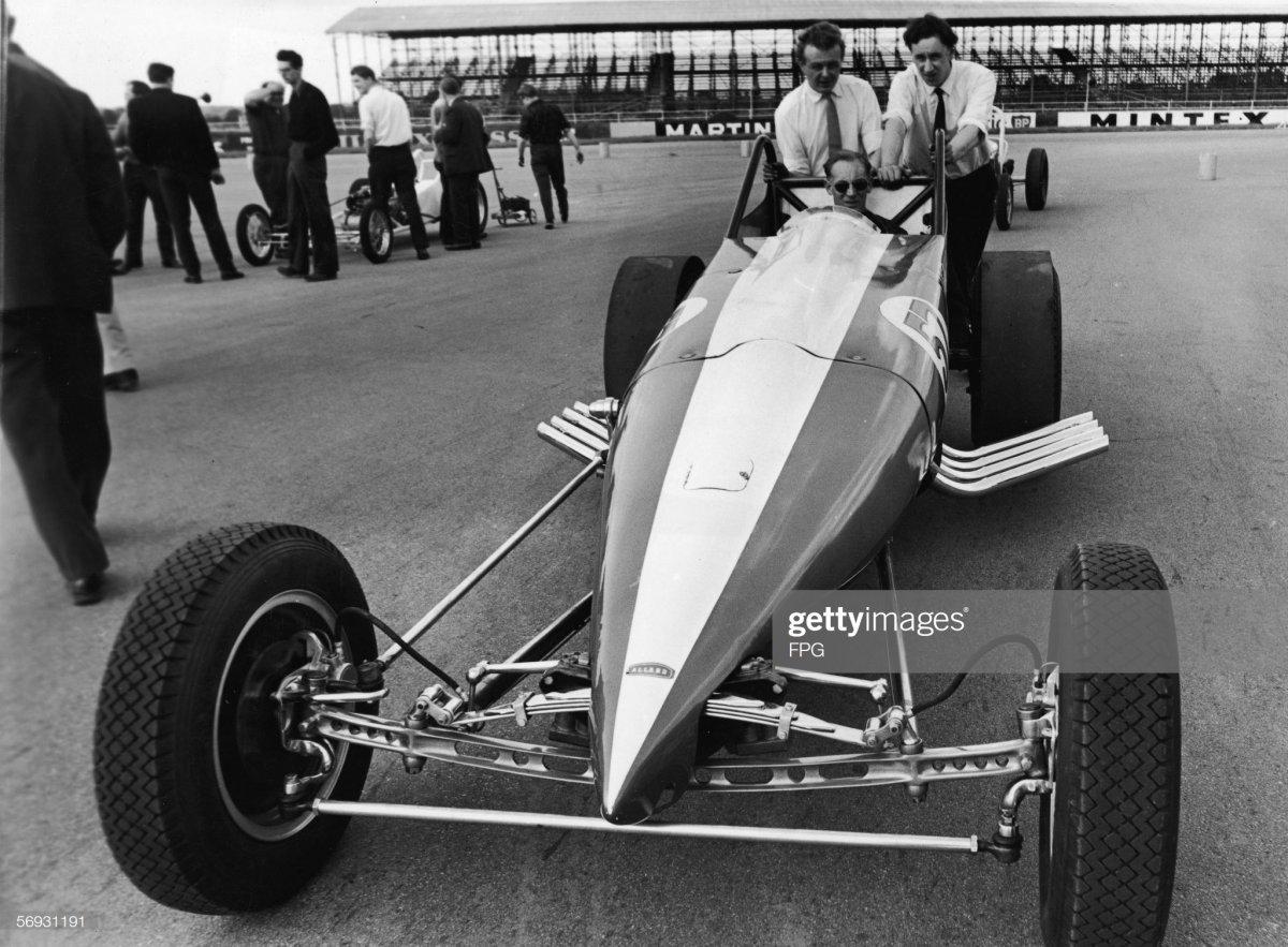 Sydney Allard (1910 - 1966) sits inside one of his custom-built.jpg