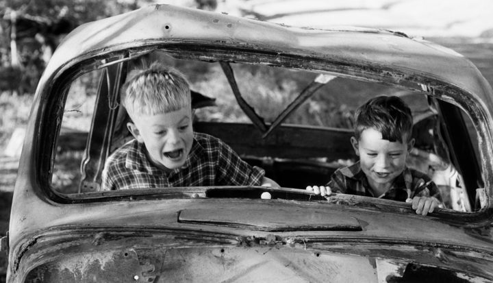 Two boys playing in wrecked car, 1957, N I NZ.jpg