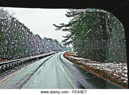 view-of-road-through-wet-windshield-fea9et.jpg