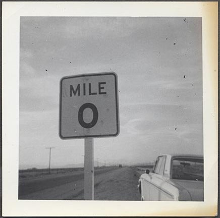 vintage-roadside-photo-ford-car-by-mile-zero-road_1_bd07e0f4007b0d36fe5ec8e850be5338.jpg