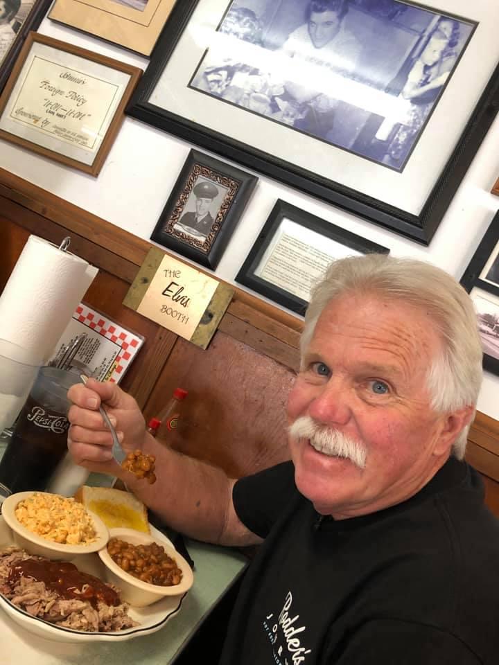 Wayne Carini in Johnnie's Drive In BBQ (Tupelo, MS) - in Elvis booth.jpg