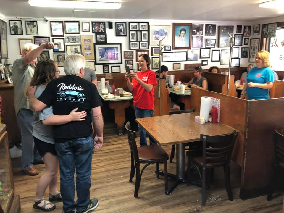 Wayne Carini in Johnnie's Drive In BBQ (Tupelo, MS) - taking photo with fans.jpg