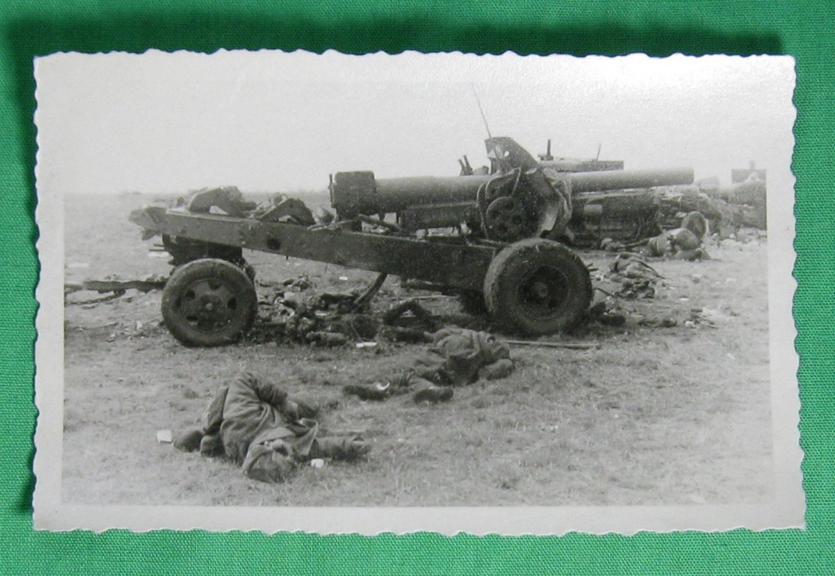 WW2_Photo_of_destroyed_Russian_artillery_and_dead_soldiers_-_Operation_Barbarossa_1941_2_2048x.jpg