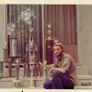 Randy with trophies, '70